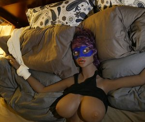 Bound sex doll gets her big tit squeezed