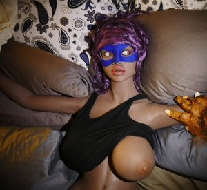 Busty sex doll is tied up and played with for fun