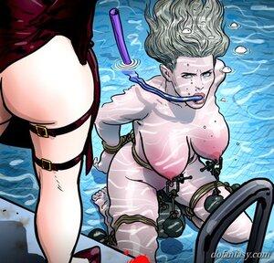 Busty slave suffers underwater